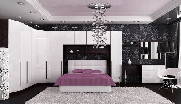 Блестящая белая поверхность мебели и потолка гармонична с черной отделкой стен и пола.