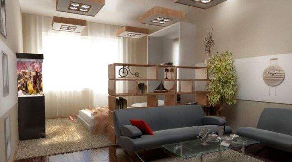Часть мебельного гарнитура можно использовать в качестве разделительной перегородки.