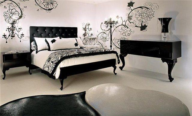 Черная мебель для спальни словно нарисована тушью на белой стене
