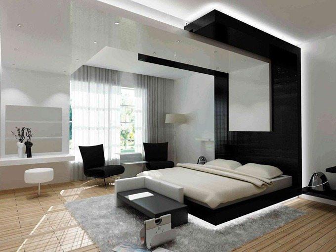 Эффектный дизайн в черно-белых тонах смягчается теплотой светлого ламината