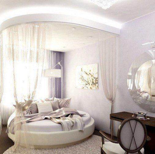 Фото комнаты с круглым ложем, оформленной в пастельных тонах.