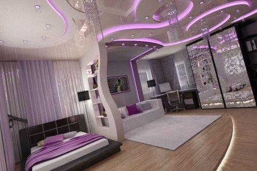 Фото совмещенной дизайнерской спальни и гостиной.