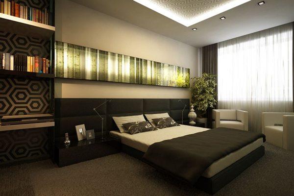 Фото спальни в темных тонах, в углу которой расположен вазон с искусственной зеленью.