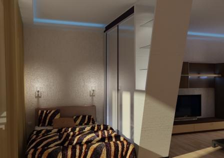 Интерьер спальни молодого человека со шкафом с деревянным фасадом.