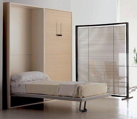 Кровать - трансформер очень удобна для небольшой спальной комнаты.