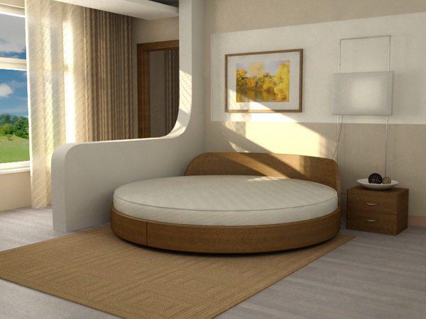 Круглая кровать в спальне, соединенной с балконом