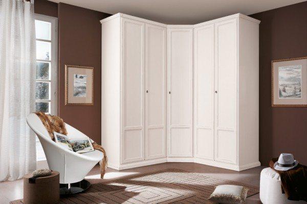 Модульный белый угловой шкаф для спальни.