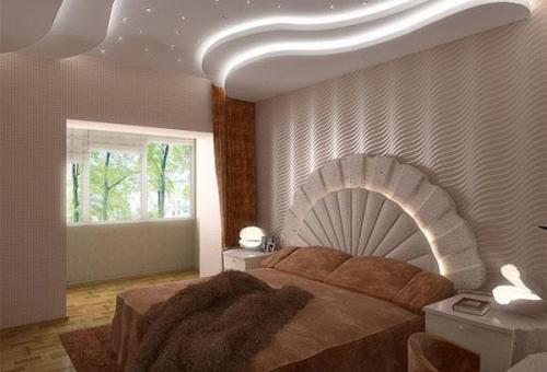 На фото эффектный потолок с витиеватыми плавными переходами и подсветкой.