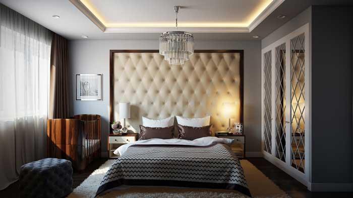 На фото коричневый и серый тона семейной спальни для родителей и младенца.
