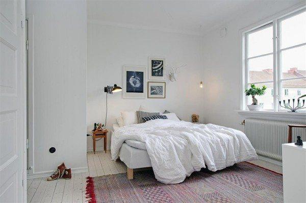 На фото показан вариант оформления спальни в скандинавском стиле.