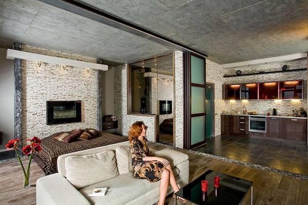 Разделение спальной и общественной зоны квартиры помощи раздвижной стеклянной перегородки.