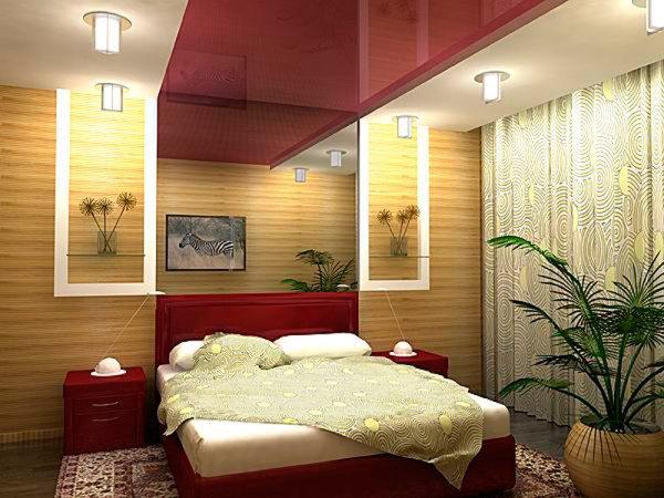 Разноуровневый стилизованный потолок достойно украсит спальню.