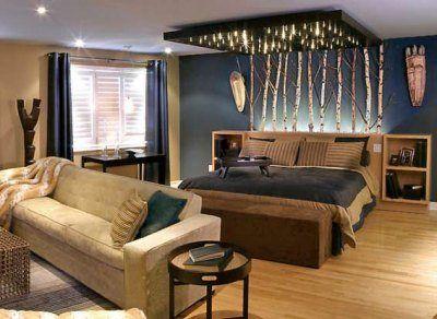 Спальня на фото декорирована березовыми ветками