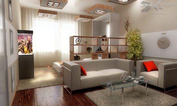 Стеллаж и диван разделяют комнату на две зоны