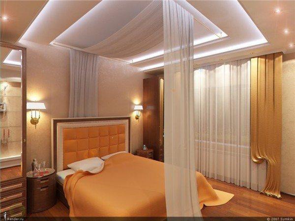Трехуровневый потолок из гипсокартона с точечными светильниками и контр ажурным освещением.